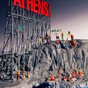 A Humorous Diorama of Athens Rocked by Protests