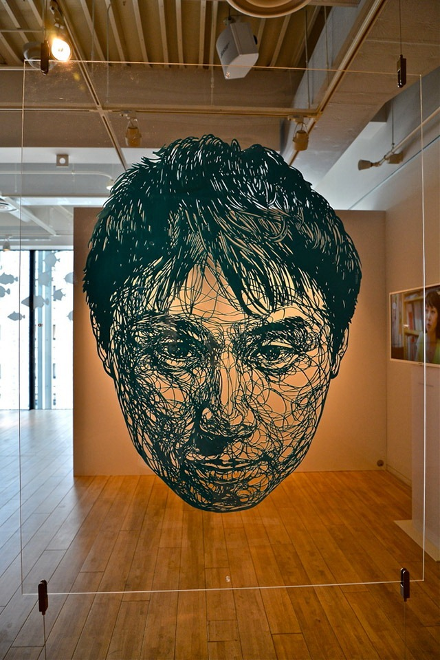 LIFE-SIZED-Large-Scale-Paper-Cutout-Installation-by-Risa-Fukui